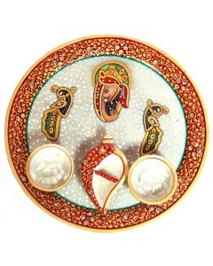 Despite the simple design of this Pooja Plate  it created a sense of devotion in any person holding it. From the centralized image of Lord Ganesh or the intricate border design interspersed with minakari and beads work  to even the small holders for ritua