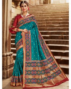 Turquise Green Silk Traditional Saree with Contrast Woven Patola Print Border and Pallu