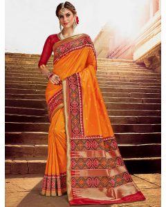 Orange Silk Traditional Saree with Contrast Woven Patola Print Border and Pallu